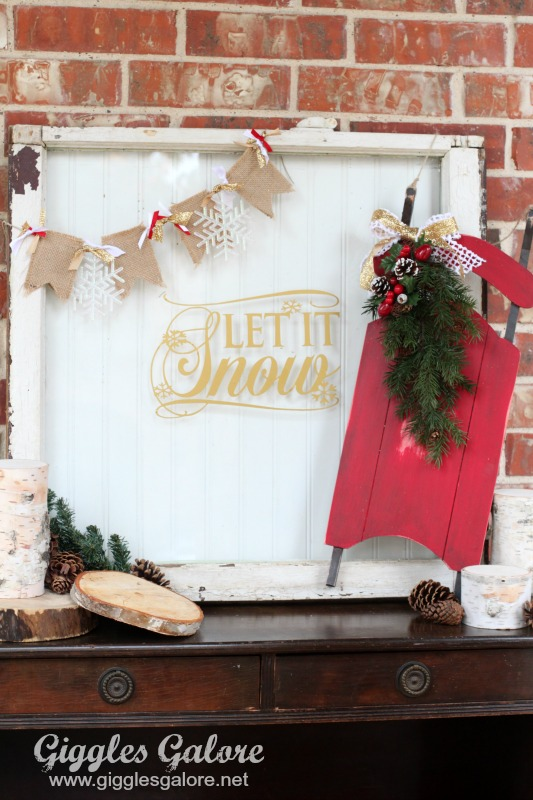let it snow vintage window and sled