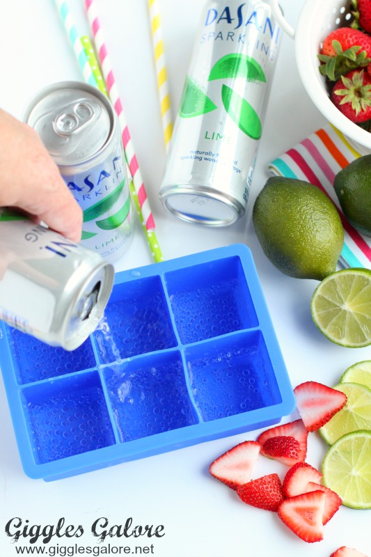 Pouring Dasani Sparkling Lime into Ice Cube Tray