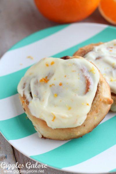 Cinnamon roll with orange cream cheese icing
