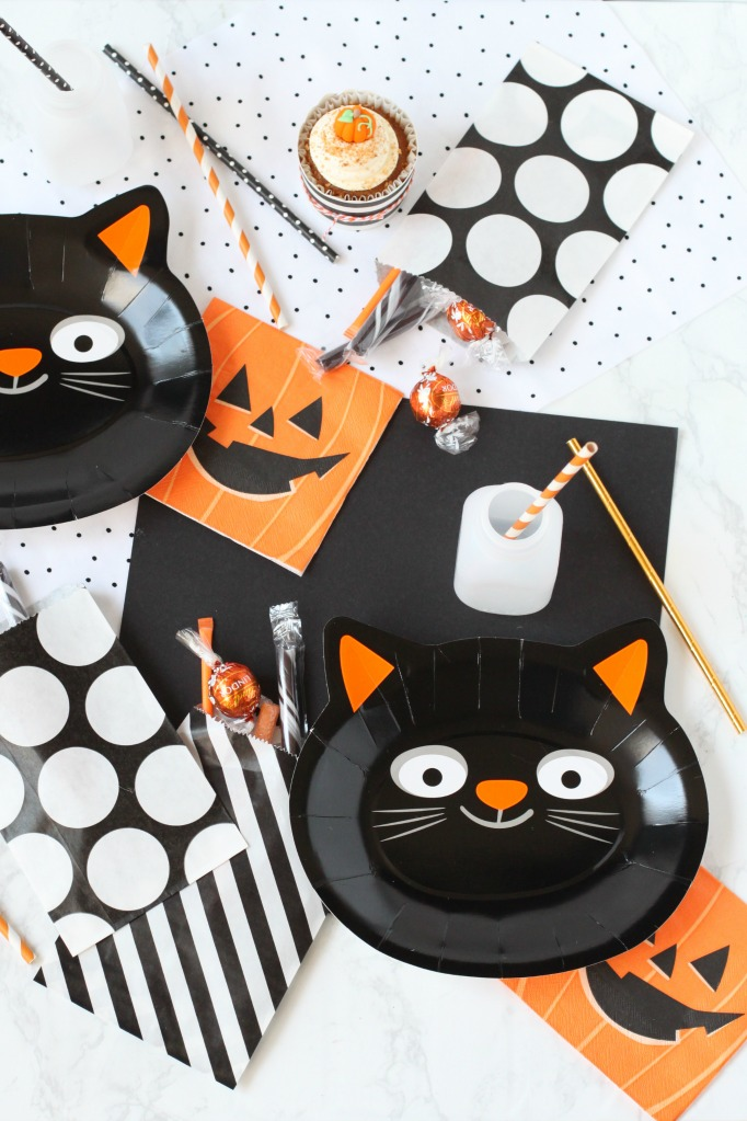 start with some cute cat plates and pumpkin napkins which you can find at michaels with the halloween party supplies