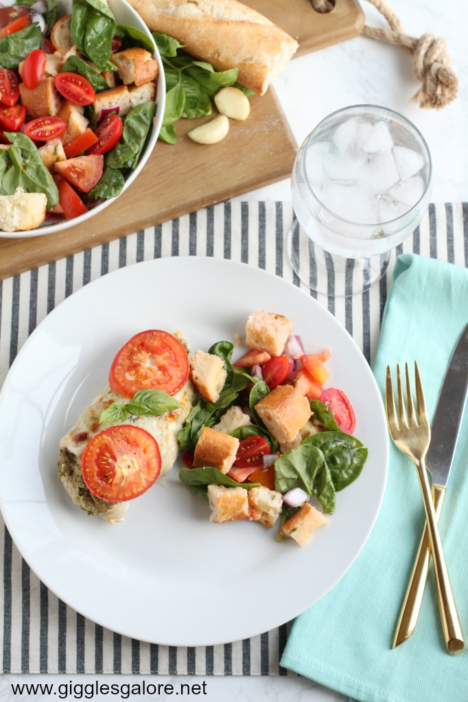 Baked artichoke pesto chicken with italian bread salad
