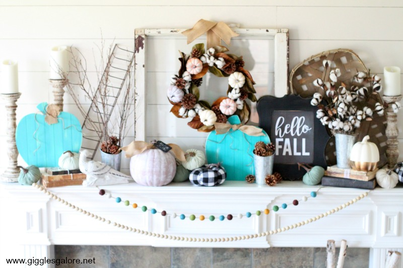 Pumpkins pinecones fall mantel decor