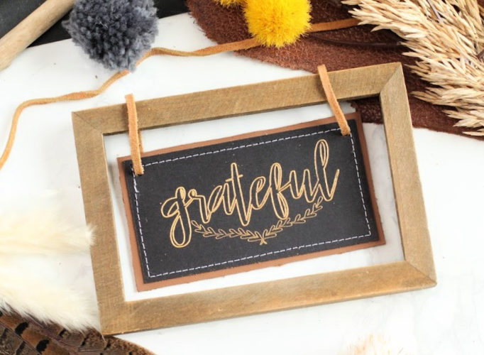 Faux leather and foil sign