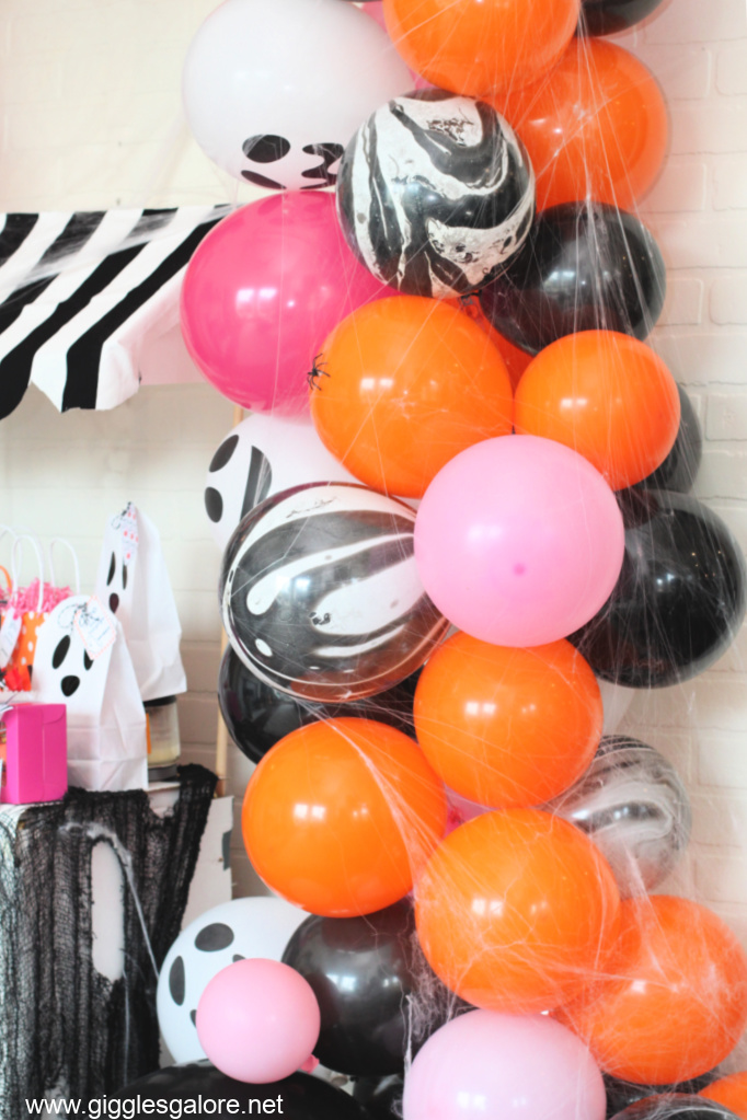 Pink and orange halloween balloon garland